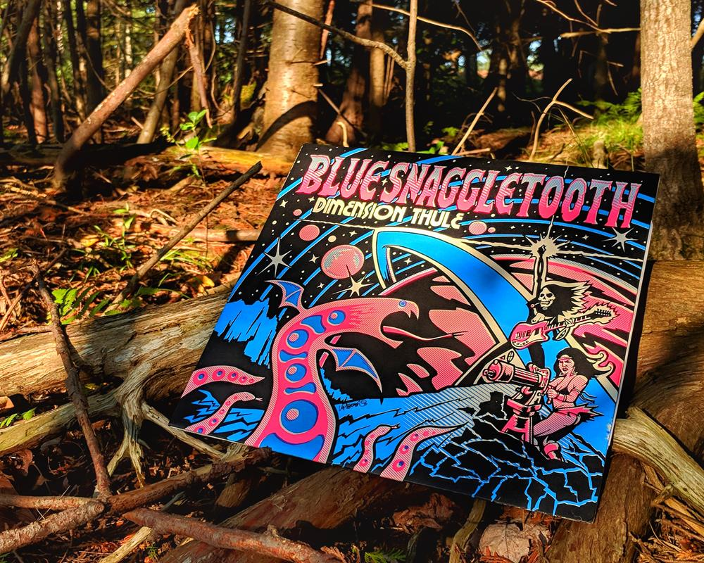 Blue Snaggletooth BlackLight Sensitive cover in tree roots